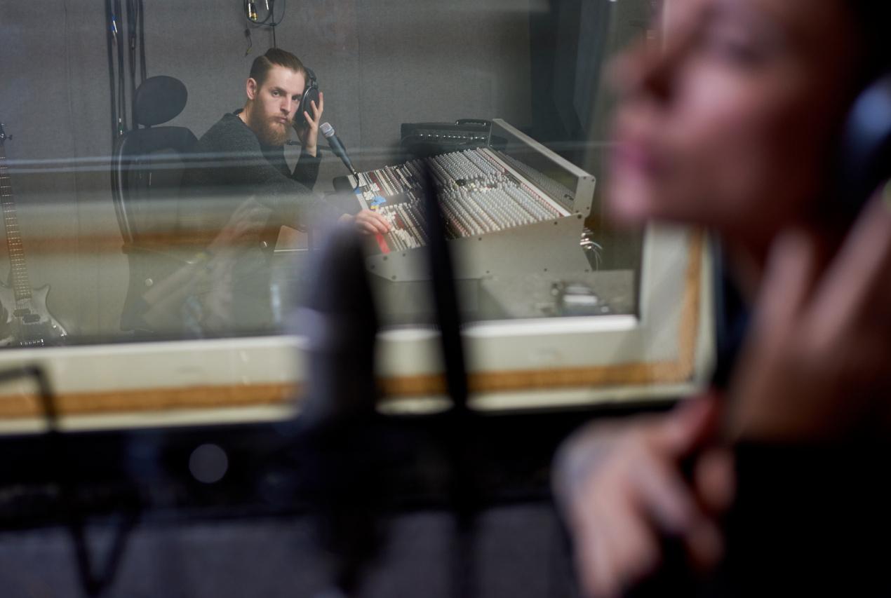 People working in recording studio