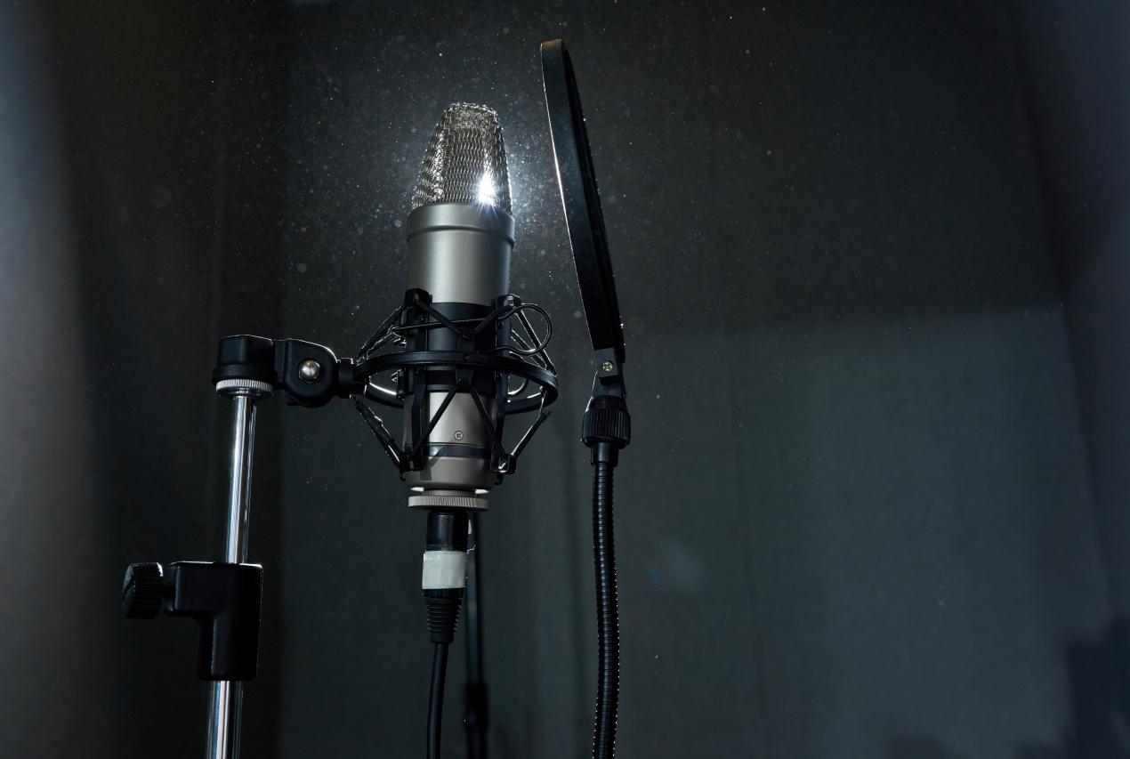 Recording microphone in dark studio